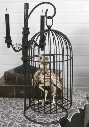 Pájaro esqueleto en jaula
