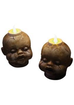 Juego de velas de té con cabezas de muñeca